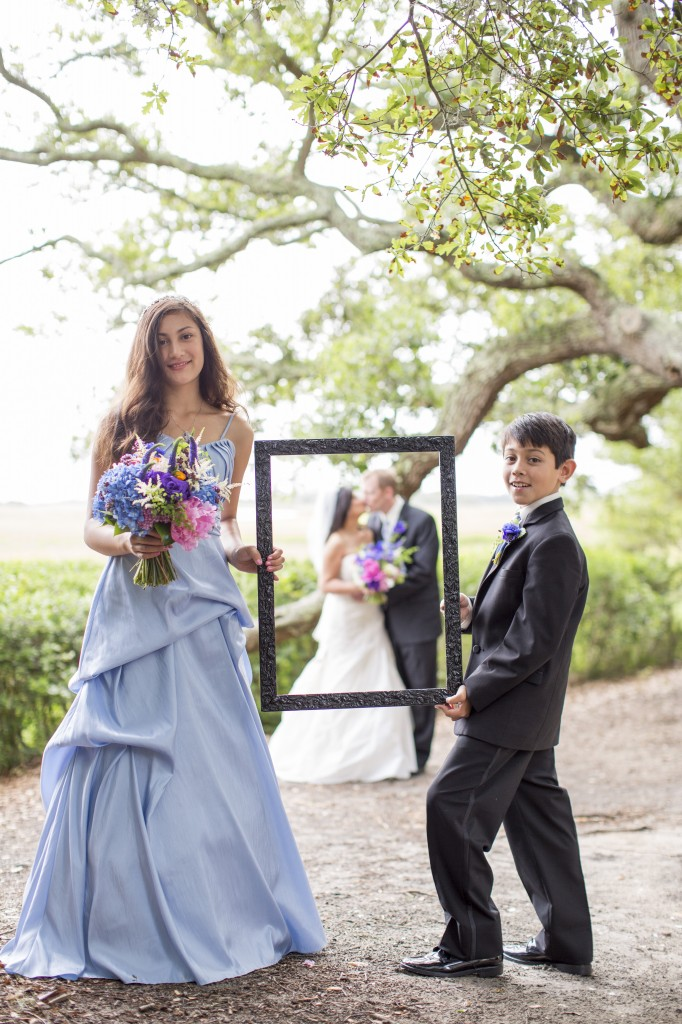 bridesmaid and ring-bearer holding frame