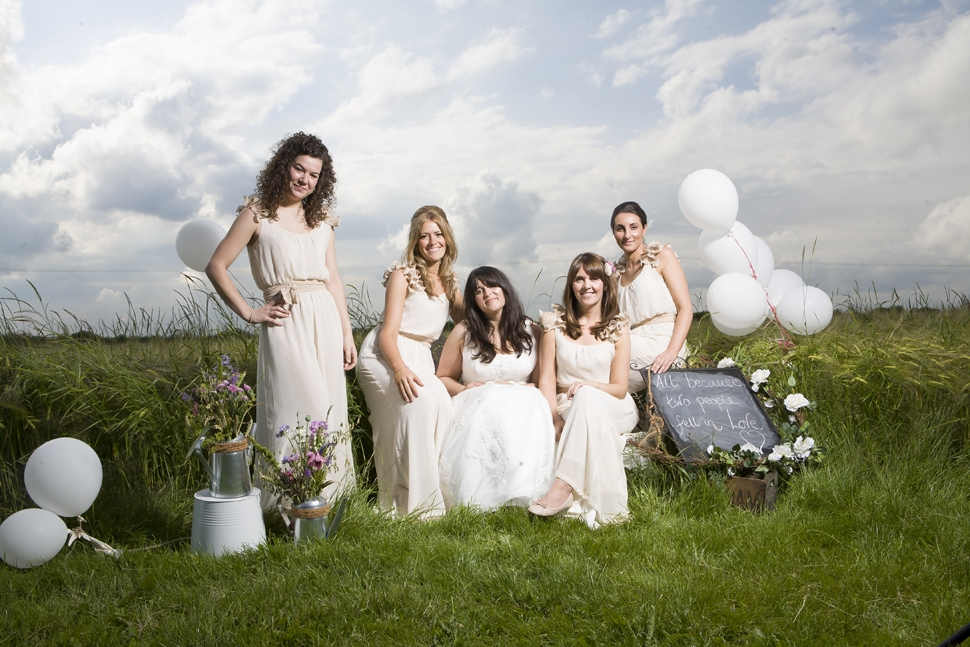 with bridesmaids in a meadow